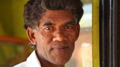 Portrait of shop owner on the streets of Mirissa, Sri Lanka. Stock Footage