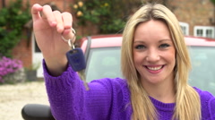 Slow Motion Shot Of Teenage Girl Standing By Car With Key Stock Footage