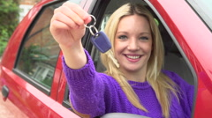 Stock Video Footage of Slow Motion Shot Of Teenage Girl Sitting In Car With Key