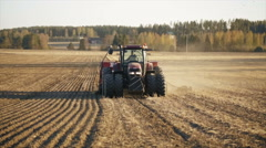 Stock Video Footage of Tractor working in the grain fields in slow motion