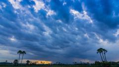 Time Lapse Nimbus Floating And Raining On Sunset Time Stock Footage