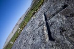Cross, Headstone in Graveyard - stock photo