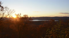 Autumn sunset over mountains with lake, leaf color 4K version Stock Footage