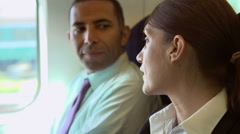 Close Up Of Two Businesspeople In Conversation On Train - stock footage
