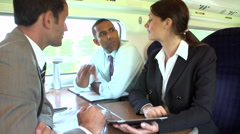 Group Of Businesspeople Having Meeting On Train - stock footage
