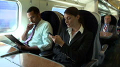 Businesspeople On Train Using Digital Devices Stock Footage