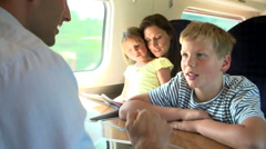Family Relaxing On Train Journey Stock Footage