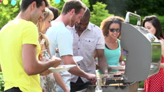 Group Of Friends Having Outdoor Barbeque At Home Stock Footage