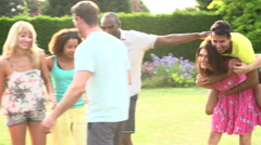Slow Motion Sequence Of Friends Playing Having Fun In Garden Stock Footage