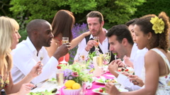 Friends Enjoying Outdoor Dinner Party Together Stock Footage