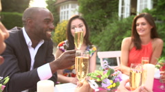 Stock Video Footage of Slow Motion Sequence Of Friends Proposing Champagne Toast