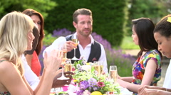 Slow Motion Sequence Of Friends Proposing Champagne Toast - stock footage