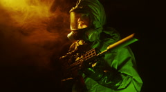 Soldier in a chemical suit standing guard with his rifle Stock Footage