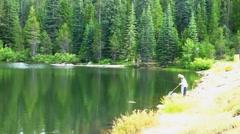 Couple Fishing Snowflower Lake Stock Footage