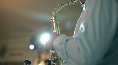 Middle-aged man saxophonist 50 years playing a musical instrument saxophone. Stock Footage