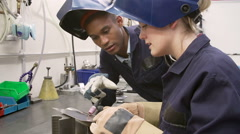 Engineer Teaching Apprentice To Use TIG Welding Machine Stock Footage