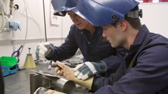 Engineer Teaching Apprentice To Use TIG Welding Machine - stock footage