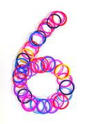 Colorful rubber band no.6 with white isolate, studio s Stock Photos