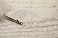 White Quill Pen on Blurred Declaration of Independence Stock Photos