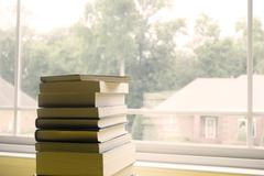 Side of Books in Front of Window Stock Photos