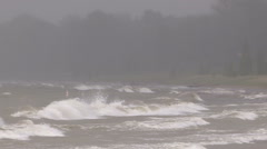 Huge powerful waves breaking at seawall in severe storm with hurricane force. Stock Footage