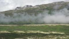 Misty Valley Clouds in Yukon Mountains Pan Left Stock Footage