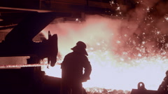 Molten metal melted in furnace at metallurgical plant 28 Stock Footage
