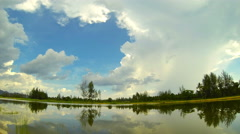 Time lapse of lake with clouds running through the sky in Thailand. 4K Stock Footage