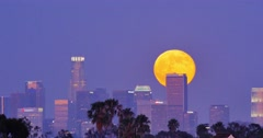 Full moon supermoon rising above downtown Los Angeles skyline at night. 4K Stock Footage