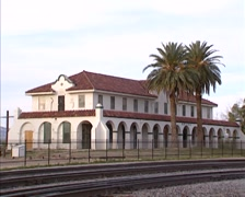 Kelso Depot in the middle of the Mojave desert + pan Union Pacific train Stock Footage
