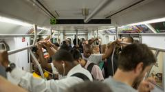 Diverse crowd of passengers on MTA subway train in New York, USA Stock Photos