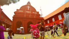Time lapse of  Christ Church  with tourists and Rickshaws in Melaka. 4K Stock Footage