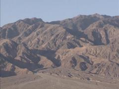 Pan - barren slopes of Tucki mountain, Death Valley National Park, early morning Stock Footage