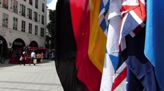 National Flags sales shopping pedestrians district Kaufingerstrasse Munich Stock Footage