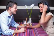 Stock Photo of young couple drinking wine and flirting