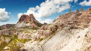 Stock Photo of view of high mountain in italy near tourist cottage