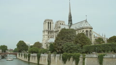 High angle view of a boat in the Seine river sailing past the Notre Dame Stock Footage