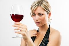 Young woman holding red wine Stock Photos