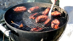 Grilling meat in the backyard - meat looking a bit burned Stock Footage