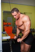 bodybuilder excercise in fitness club - stock photo