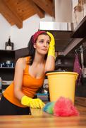 portrait of overworked woman in kitchen - stock photo