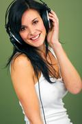 young women listening music - stock photo