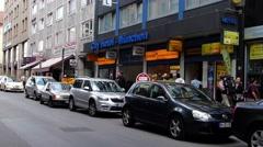 Schiller strasse full of hotels n oriental supermarket street scene Munich Stock Footage