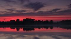 Sunrise over the reservoir in Vyshny Volochyok, Vyshnevolotsk district, Stock Footage