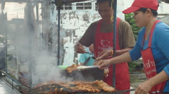 Thai Street Food Vendors Selling Som Tum and Grilled Meats Stock Footage
