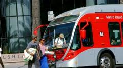 4K, UHD, Passengers boarding public bus on Wilshire Boulevard in Santa Monica Stock Footage