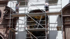 Construction Workers building up metal scaffolding Munich Germany Europe Stock Footage