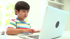 Young Asian Boy Using Laptop At Home Stock Footage