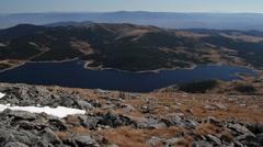 Bird-eye view to blue mountain dam Stock Footage