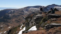 Hikers with backpack standing on top of a mountain Stock Footage